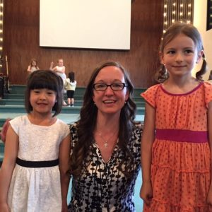 Moonbeam students Ella Stroet and Mariam Carter with MYC teacher Hannah Hamm at their June Recital.